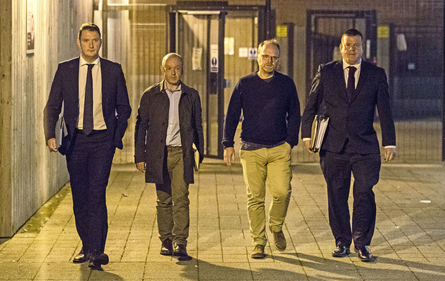 From left, solicitor John Finucane with his client, investigative journalist Barry McCaffrey, and Trevor Birney with his solicitor Niall Murphy leaving Musgrave police station in Belfast on Friday night. Picture by Liam McBurney/PA.