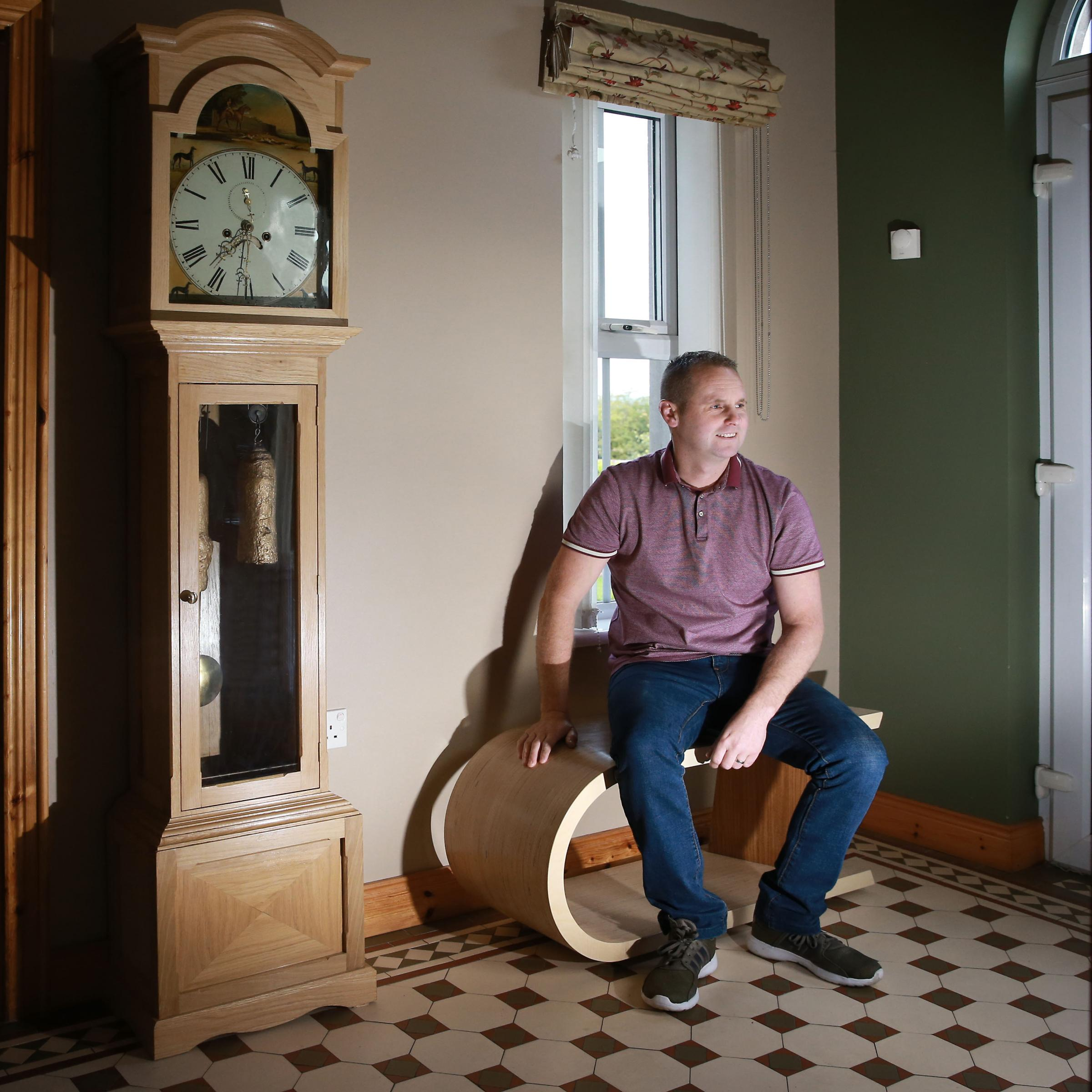 Ian McElroy with his grandfather clock..