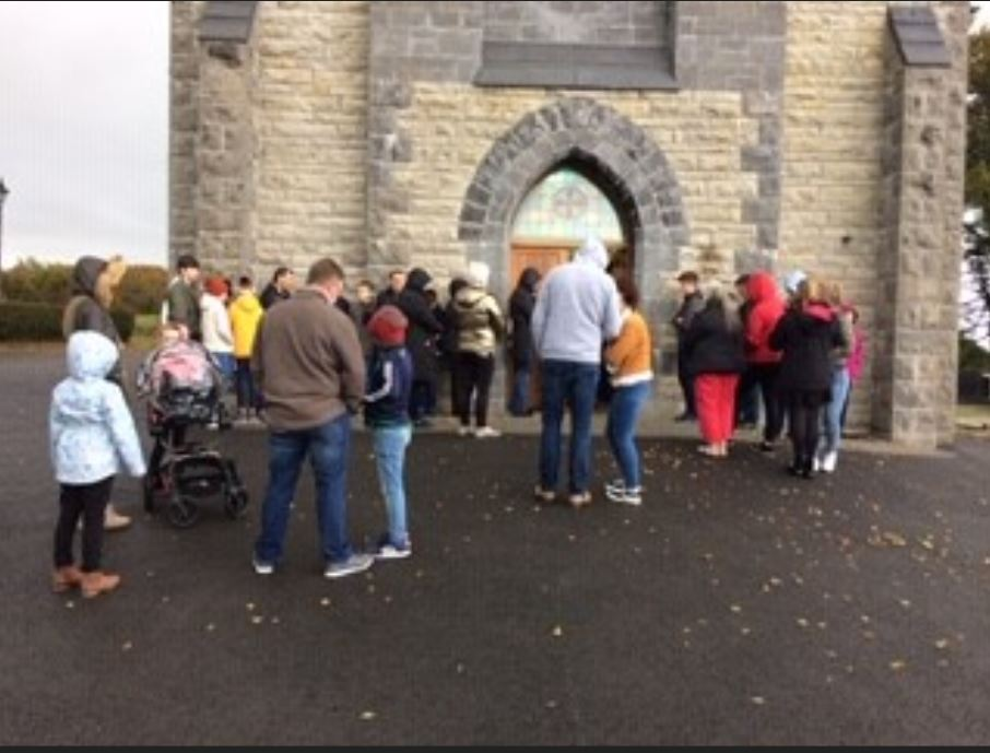Parishioners had to stand outside Sacred Heart Church, Boho at Sunday Mass due to a full capacity inside the church.