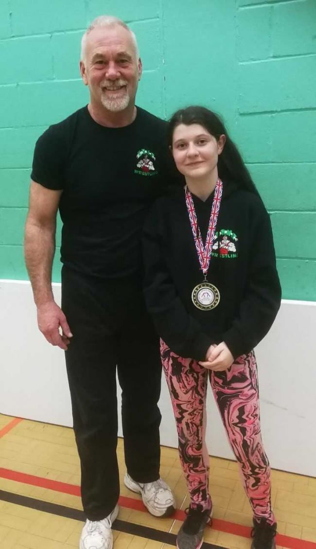 Charlotte McGuigan and coach Bruce Irwin