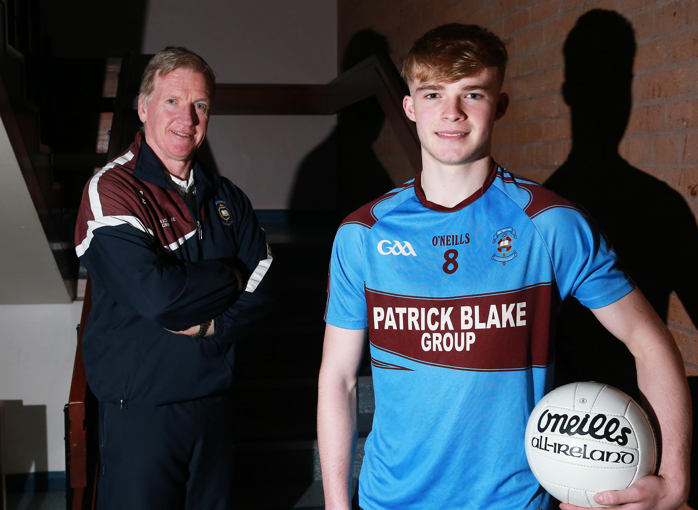 Brandon Horan, Ulster College All Star 2018-19 with MacRory Cup Manager Dom Corrigan.