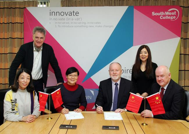 Pictured signing the MOU are:Front row: Gu Mingzhu, Deputy Director of the Academic Affairs Office, Ji Linli Principal, Michael McAlister, Chief Executive SWC, Nicholas O'Shiel, Chair, Governing Body.Back row: Andrew Thompson, Chief Executive Excell