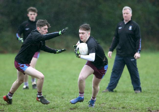 St Michael's coach Dom Corrigan puts his players through their paces at training this week.