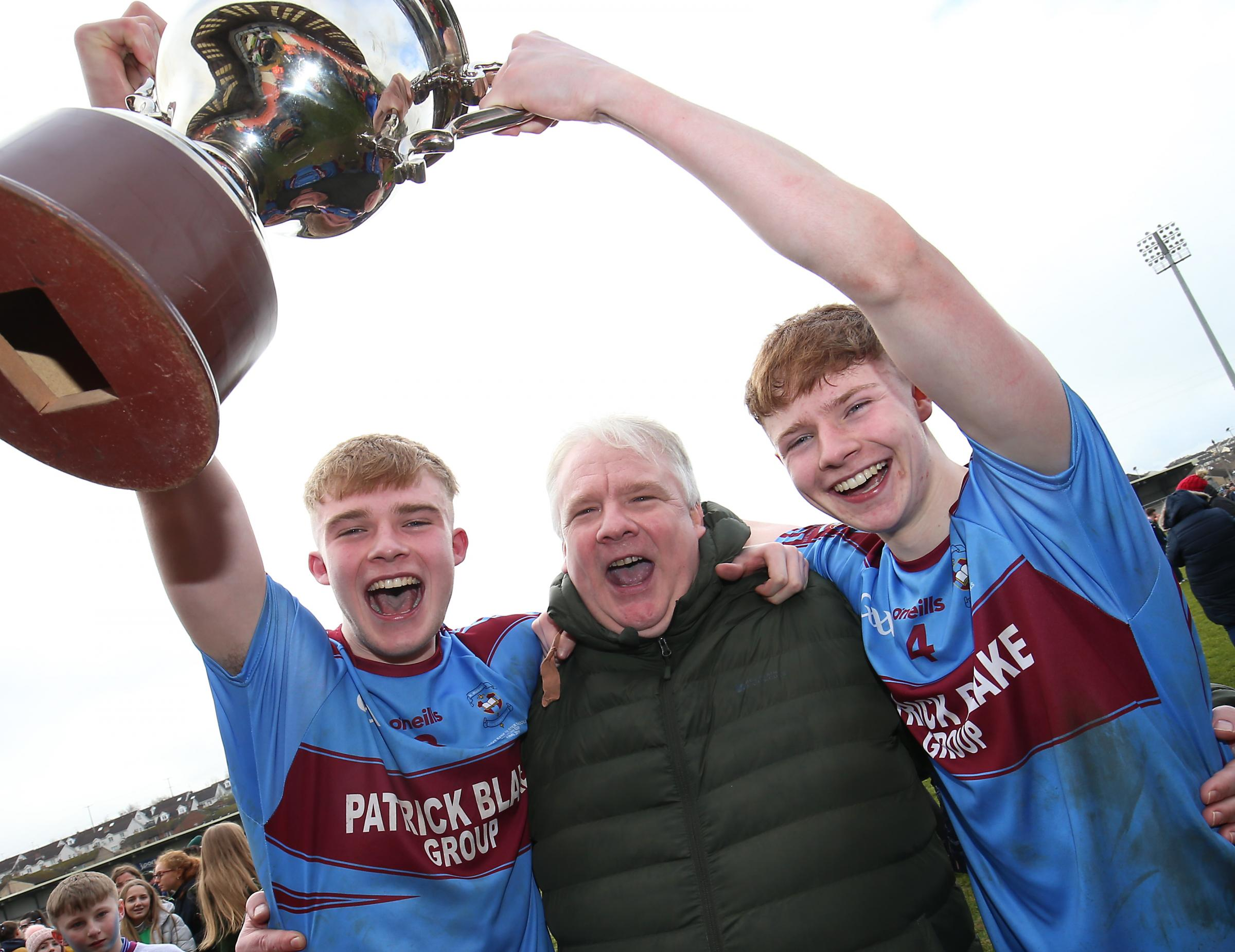 St.Michaels Brandon and Josh Horan with their father Kevin enjoy the celebrations over Omagh CBS, MacRory Cup Final 2019. Picture by John McVitty © - 07771987378 - ©