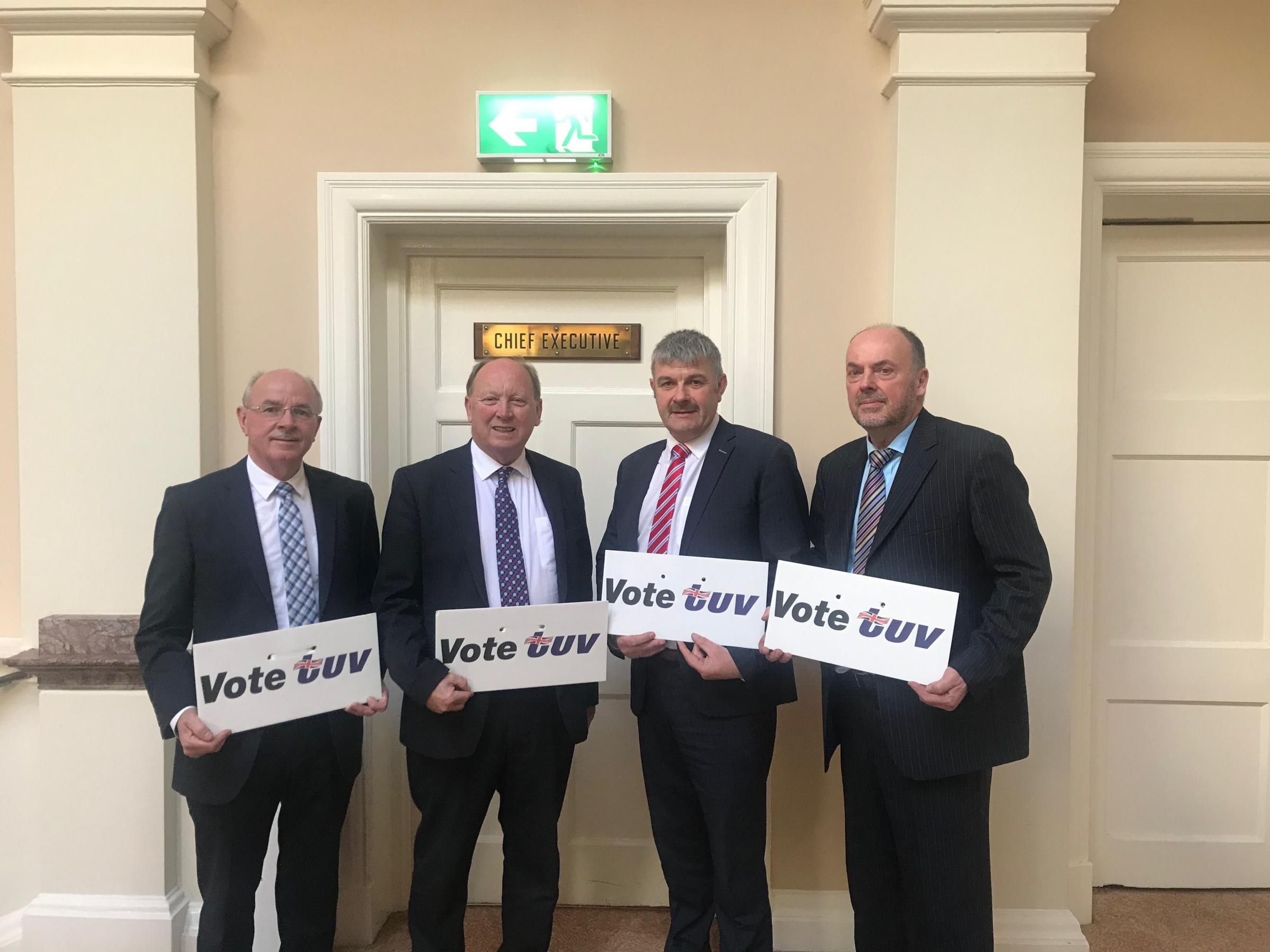 TUV candidates with their party leader Jim Allister (second from left) at the Townhall. From left - Charlie Chittick (Omagh Town), Donald Crawford (Enniskillen) and Alex Elliott (Erne North)