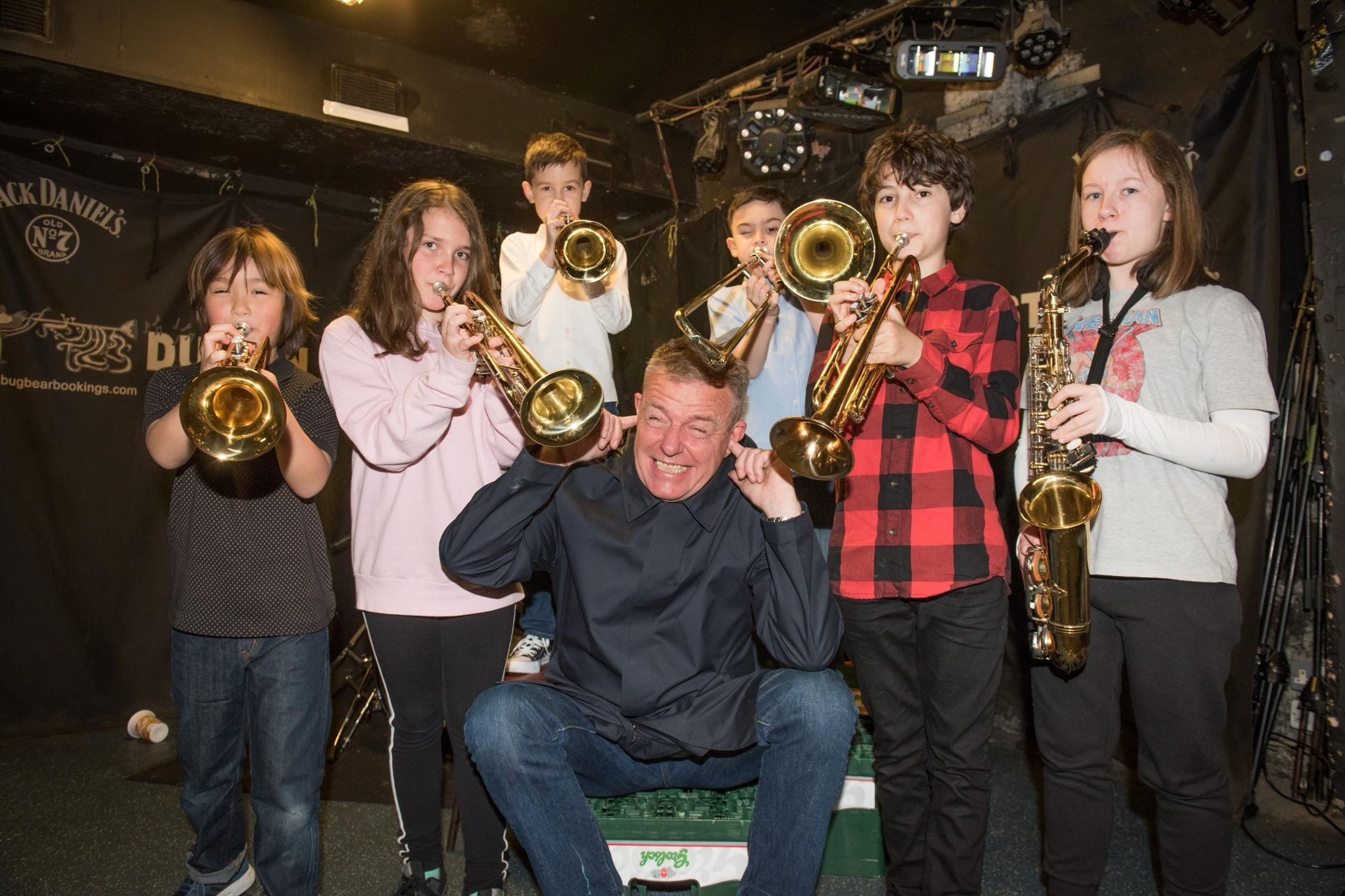 Suggs with some young musicians