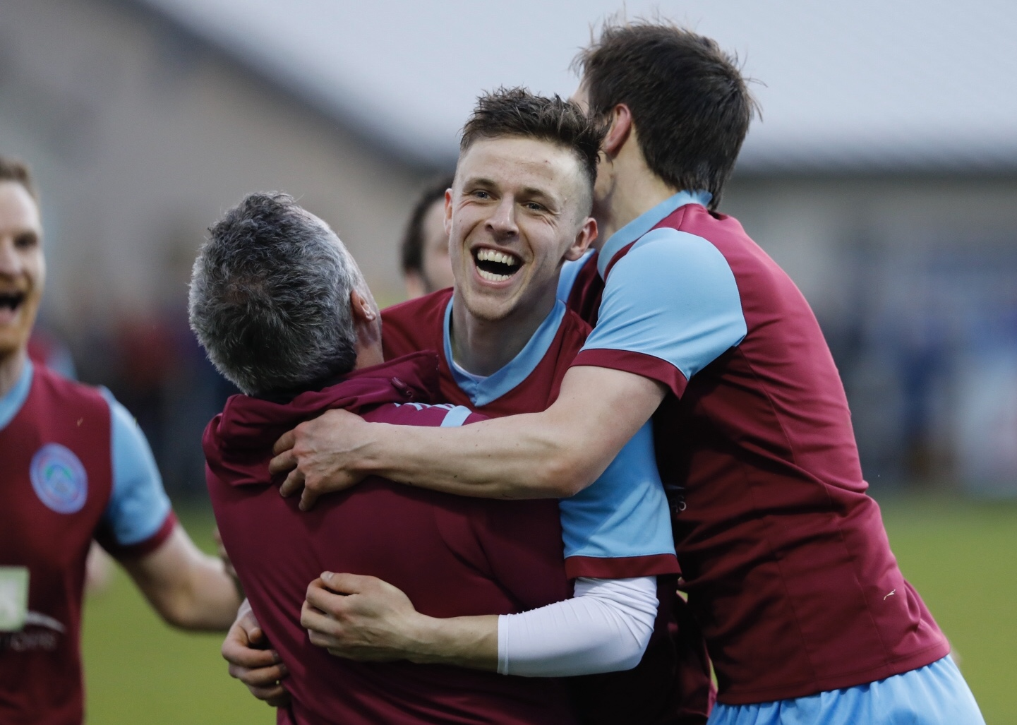 Emmet McNabb celebrates with manager Gerry Love after scoring Tummery's third goal.