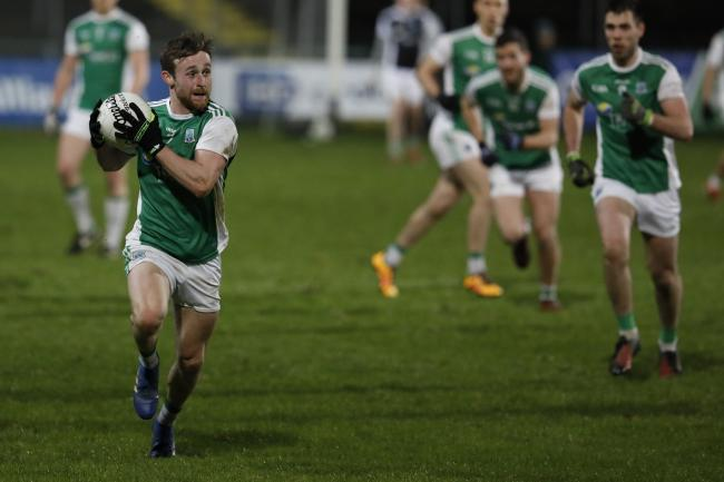 Ciaran Corrigan breaks forward.
