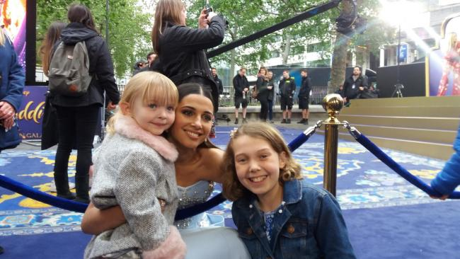Emily (right) with her sister Luciana and Princess Jasmine (Naomi Scott) at the premiere of Aladdin in London.
