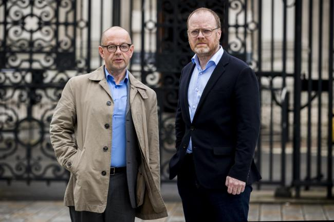 Investigative journalists Barry McCaffrey (left) and Trevor Birney standing outside Belfast High Court, who have told the police to drop their case after judges indicated their warrants will be quashed after being arrested for airing confidential materia