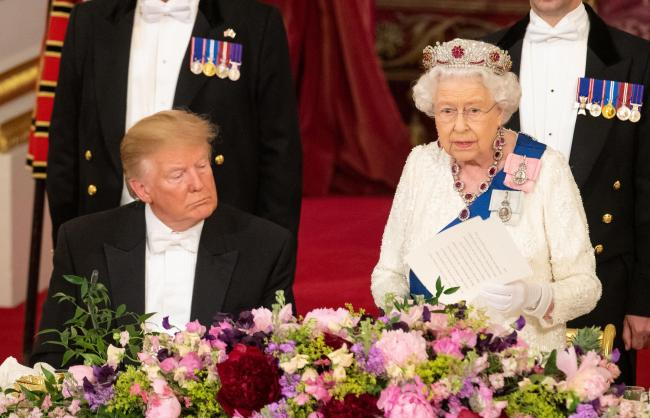 US President Donald Trump listens as Queen Elizabeth II makes a speech during the State Banquet at Buckingham Palace, London, on day one of President Trump's three day state visit to the UK. Photo: Dominic Lipinski/PA Wire